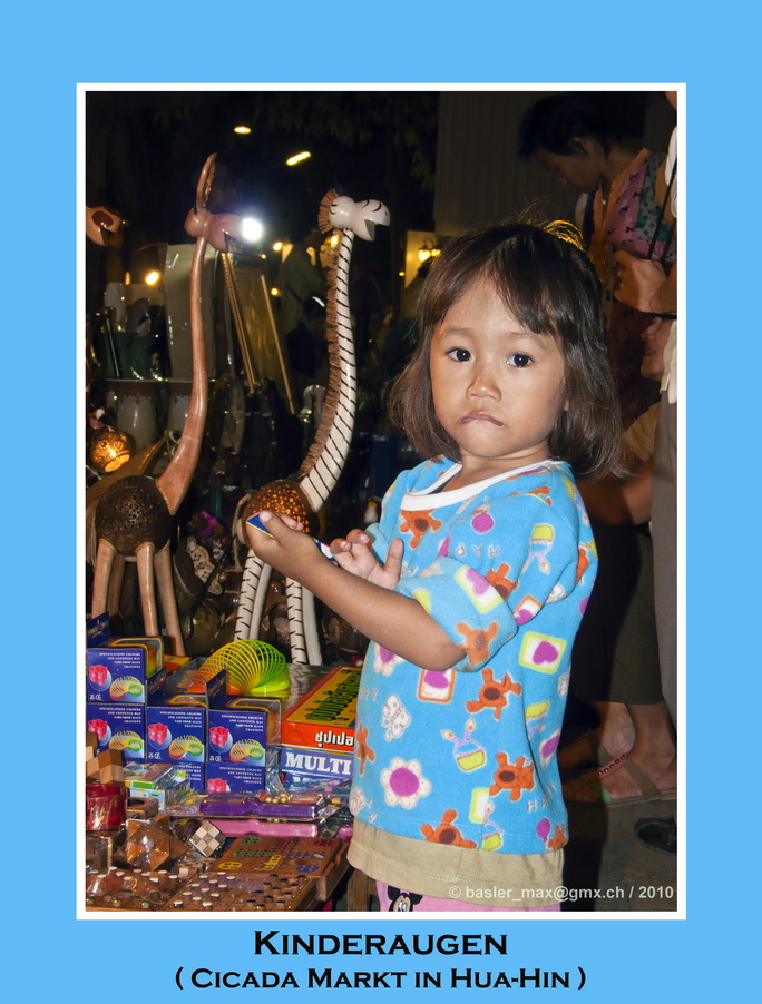 Kinderaugen auf dem Cicada Market in Hua-Hin
